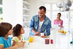 Family eating breakfast inside